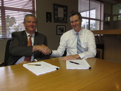 Reutech's Chief Operating Officer, Peter van der Bijl and Michael Frangenberg, Director Procurement of Soitec's Solar Energy Business Unit, signing the equipment supplier agreement.